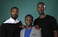 "Tarell Alvin McCraney, right, creator/executive producer of the OWN series ""David Makes Man,"" poses with executive producer Michael B. Jordan, left, and cast member Akili McDowell for a portrait during the 2019 Television Critics Association Summer Press Tour."