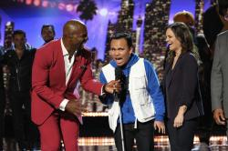 """Host Terry Crews, left, and singer Kodi Lee on the NBC television show, """"America's Got Talent,"""" in Los Angeles."""