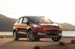 This undated photo provided by Ford shows the 2016 Ford Escape, a small crossover SUV. On upper trim levels, it comes with auto-dimming mirrors, blind-spot monitoring and automated parking