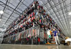 Hundreds of thousands of garments are stored on a tri-tiered conveyor system at the ThredUp sorting facility.