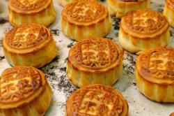 """Mooncakes with Chinese words """"No withdrawal, no dispersal"""" are placed on the table at Wah Yee Tang bakery in Hong Kong."""
