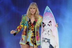 Taylor Swift accepts the Icon award at the Teen Choice Awards in Hermosa Beach, Calif.