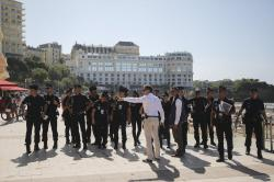 French police officers get instructions in front of the Le Bellevue at the beach promenade ahead of the upcoming G7 Summit, in Biarritz, France, Thursday, Aug. 22, 2019