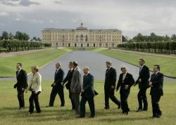 In this July 16, 2006, file photo G8 leaders from left, Italy's Prime Minister Romano Prodi, German Chancellor Angela Merkel, U.S. President George W. Bush, British Prime Minister Tony Blair, French President Jacques Chirac, Russian President Vladimir Putin, Canadian Prime Minister Stephen Harper, Japan's Prime Minister Junichiro Koizumi, Finnish Prime Minister Matti Vanhanen and European Commission President Jose Manuel Barroso, walk off following a group photo in front of the Konstantinovsky Palace in St. Petersburg, Russia