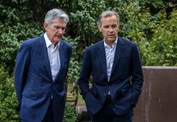 Federal Reserve Chairman Jerome Powell, left, and Bank of England Governor Mark Carney, right, walk together after Powell's speech at the Jackson Hole Economic Policy Symposium on Friday, Aug. 23, 2019, in Jackson Hole, Wyo.
