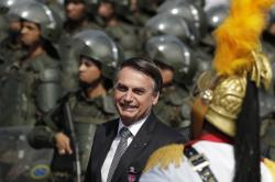 Brazils President Jair Bolsonaro arrive to attend a military ceremony for the Day of the Soldier, at Army Headquarters in Brasilia, Brazil, Friday, Aug. 23, 2019