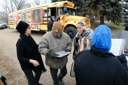 In this Tuesday, Nov. 6, 2018 file photo Judith LeBlanc, left, with Four Directions, a non-profit voting equality organization for Native Americans, helps local volunteers before going door-to-door looking for voters in Selfridge, N.D., and offering a free bus ride to the polling precinct