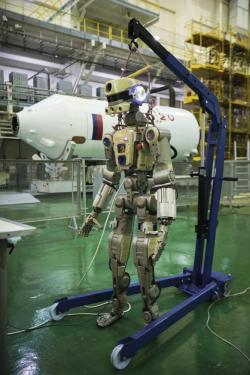 In this photo taken on Friday, July 26, 2019, and distributed by Roscosmos Space Agency Press Service, the Fedor robot is displayed before being loaded into a Soyuz capsule that was launched Thursday Aug. 22, 2019, from the launch pad at Russia's space facility in Baikonur, Kazakhstan