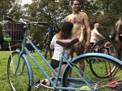 Nude bicyclist Oren Roth-Eisenberg has a message opposing fossil fuel consumption painted on his torso by his wife before the start of the Philly Naked Bike Ride in Philadelphia on Saturday, Aug. 24, 2019