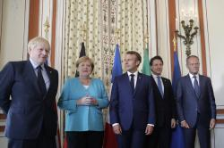 From the left, Britain's Prime Minister Boris Johnson, German Chancellor Angela Merkel, French President Emmanuel Macron, Italian Premier Giuseppe Conte and President of the European Council Donald Tusk pose during a G7 coordination meeting with the Group of Seven European members at the Hotel du Palais in Biarritz, southwestern France, Saturday, Aug.24, 2019