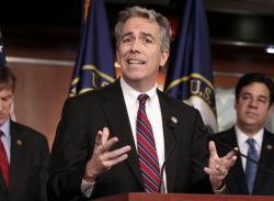 In this Nov. 15, 2011, file photo former U.S. Rep. Joe Walsh, R-Ill., gestures during a news conference on Capitol Hill in Washington. Walsh, a former Illinois congressman, says he'll challenge President Donald Trump for the Republican nomination in 2020