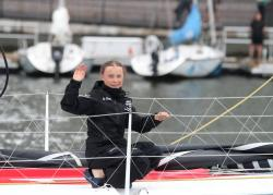 Greta Thunberg, a 16-year-old Swedish climate activist, waves after sailing in New York harbor aboard the Malizia II, Wednesday, Aug. 28, 2019