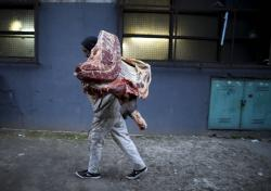 A butcher loads meat from a truck in Buenos Aires, Argentina.