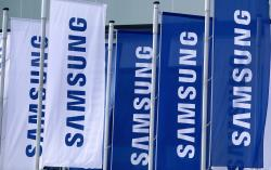 Flags of the Samsung company wave in front of a fairground entrance of the IFA 2019 tech fair in Berlin, Germany, Wednesday, Sept. 4, 2019
