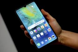 A staff member holds a Huawei 'Mate20 X 5G' smartphone at the IFA 2019 tech fair in Berlin, Germany, Thursday, Sept. 5, 2019