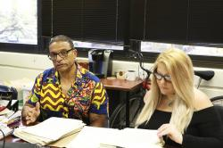 In this Tuesday, Sept. 3, 2019 photo, Hawaii Innocence Project co-director Kenneth Lawson, left, explains the case of a former U.S. soldier convicted of a 1982 murder, while University of Hawaii law student Alanna Wade looks through the legal file in Honolulu