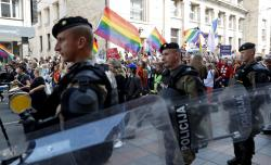 Policemen guard the country's first ever LGBT pride parade in downtown Sarajevo, Bosnia-Herzegovina.