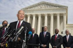 Nebraska Attorney General Doug Peterson with a bipartisan group of state attorneys general speaks to reporters in front of the U.S. Supreme Court in Washington, Monday, Sept. 9, 2019