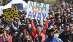 In this March 24, 2018, file photo, crowds of people participate in the March for Our Lives rally in support of gun control in San Francisco