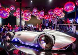 "The Mercedes concept car ""EQ Silver Arrow"" is surrounded by media people at the IAA Auto Show in Frankfurt, Germany, Monday, Sept. 9, 2019"