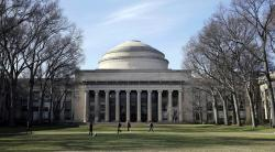 "In this April 3, 2017 file photo, students walk past the ""Great Dome"" atop Building 10 on the Massachusetts Institute of Technology campus in Cambridge, Mass."