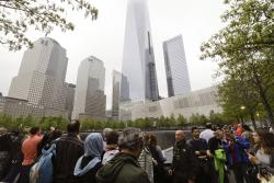 Visitors gather near the pools at the 9/11 Memorial in New York.