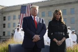President Donald Trump and first lady Melania Trump participate in a moment of silence honoring the victims of the Sept. 11 terrorist attacks.