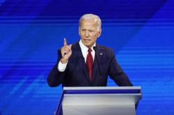Democratic presidential candidates former Vice President Joe Biden, left, and Sen. Elizabeth Warren, D-Mass., shake hands Thursday, Sept. 12, 2019, after a Democratic presidential primary debate hosted by ABC at Texas Southern University in Houston