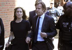 Felicity Huffman arrives at federal court with her husband William H. Macy for sentencing in a nationwide college admissions bribery scandal in Boston.