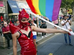 A participant waves a rainbow flag during the annual gay pride in Belgrade, Serbia.