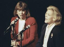 Phyllis Newman, left, and Lauren Bacall sing during a tribute to the late conductor Leonard Bernstein, at New York's Majestic Theatre in 1990.