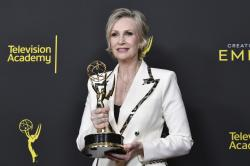 """Jane Lynch poses in the press room with the award for outstanding guest actress in a comedy series for """"The Marvelous Mrs. Maisel"""" on night two of the Creative Arts Emmy Awards."""
