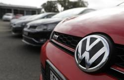 Display cars are parked at a Volkswagen dealership in Sydney, Monday, Sept. 16, 2019