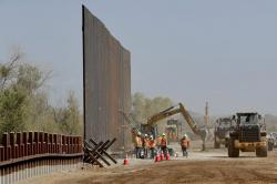 Government contractors erect a section of Pentagon-funded border wall along the Colorado River, Tuesday, Sept. 10, 2019 in Yuma, Ariz.