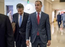 President Donald Trump's former campaign manager Corey Lewandowski, right, and his lawyer Peter Chavkin, left, arrive to meet behind closed doors with the House Intelligence Committee, at the Capitol.