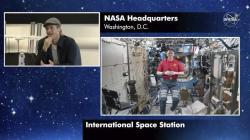 "Brad Pitt, left, star of the new space movie ""Ad Astra,"" speaks from NASA headquarters in Washington, to astronaut Nick Hague abroad the International Space Station."