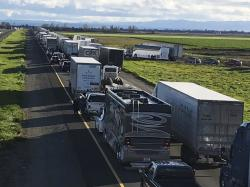 This Feb. 14, 2019, photo released by Caltrans District 3 shows a 7-mile back up on the South bound Interstate 5, as it reopens to traffic in Maxwell in Colusa County, Calif.