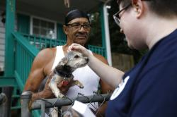 Sylvanus Jackson brings his dog out to meet Lizzy Trawick, a coordinator for LifeLine Animal Project's Pets for Life program in Atlanta.