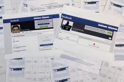 Pages from a confidential whistleblower's report obtained by The Associated Press, along with two printed Facebook pages that were active on Tuesday, Sept. 17, 2019, are photographed in Washington