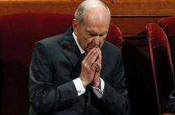 The Church of Jesus Christ of Latter-day Saints President Russell M. Nelson prays during the church's twice-annual, in Salt Lake City.