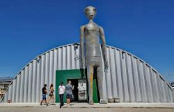 People enter and exit the Alien Research Center in Hiko, Nev.
