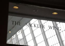 In this Jan. 17, 2019, file photo, a sign with the Sackler name is displayed at the Metropolitan Museum of Art in New York