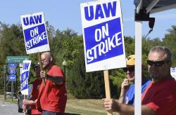 Members of United Auto Workers Local 1590 picket near the GM Martinsburg Parts Distribution Center in Martinsburg, W.Va.,, Thursday, Sept. 19, 2019, during the fourth day of a nationwide work stoppage involving about 49,000 union workers