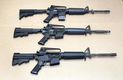In this Aug. 15, 2012 file photo, three variations of the AR-15 rifle are displayed at the California Department of Justice in Sacramento, Calif.