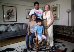 In this Wednesday, Aug. 21, 2019 photo, Guatemalan immigrant Rosayra Pablo Cruz, far left, and her sons Yordy, 17, and Fernando, 6, pose with their host Vivien Tartter, a college professor who opened her home to the family for a year, in New York