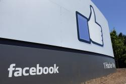 This July 16, 2013, file photo, shows a sign at Facebook headquarters in Menlo Park, Calif.