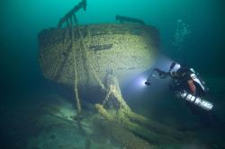In this Aug. 24, 2019, photo provided by John Janzen, diver John Scoles maneuvers around the wreckage of the schooners Peshtigo and St. Andrews, lost in 1878 near Beaver Island in northern Lake Michigan.