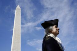 John Lopes, playing the part of President George Washington, stands near the Washington Monument following a ribbon-cutting ceremony with first lady Melania Trump to re-open the monument, Thursday, Sept. 19, 2019, in Washington