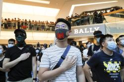 Anti-government protesters as people sing during a rally inside a shopping mall at Sha Tin district in Hong Kong Sunday, Sept. 22, 2019.