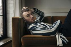 "Sam Smith poses to promote their latest album, ""The Thrill of It All."""